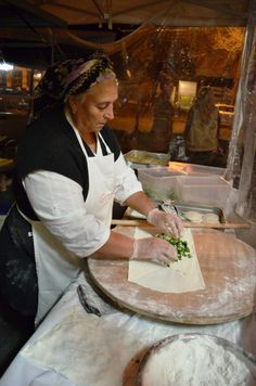 A lady making gozmele - a delicious handmade pastry traditionally filled with spinach and feta cheese.