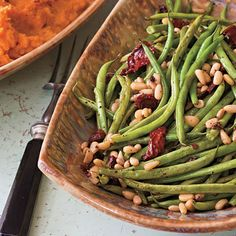 Roasted Green Beans with Sun-dried Tomatoes Recipe | MyRecipes.com - this looks good!  recipe says you could also sub. brussel sprouts