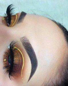 Orange, purple plum, gold half-cut crease w/ yellow liner