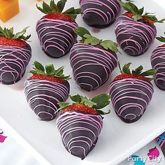 Black and pink Candy Melts® drizzled over strawberries make for a monstrously-cute dessert!