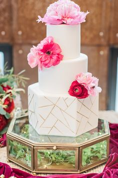 Three tier cake with gold geometric detail and pink peonies