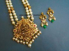The two stringed south sea pearls long chain with gold balls in between is attached to a antique gold Lakshmi pendant with kundans. Paired with Kundan gold earrings. Pearl Necklace Designs, Gold Earrings Designs, Gold Jewellery Design, Bead Jewellery, Beaded Jewelry, Gold Jewelry, Gold Necklace, Pearl Jewelry, Gold Designs