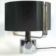 Jacques Quinet; Chrome-Plated Brass and Enameled Metal Table Lamp, 1970s.