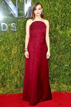 Skylight's leading lady Carey Mulligan who's nominated Best Performance By An Actress in a Leading Role in a Play, strolled up Radio City wearing an oxblood Balenciaga dress with a half-moon neckline, which she teamed with a gold statement bracelet.