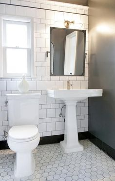 Digital Art Gallery Black and white bathroom features a Restoration Hardware Industrial Rivet Flat Mirror Pivot lit by a