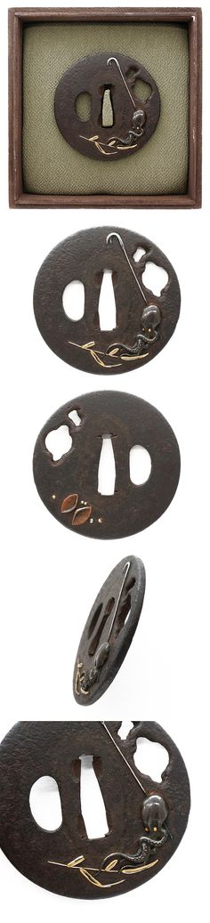 The octopus, the fishhook and the shell are carved into an iron Tsuba, and painted with gold, silver and copper color.