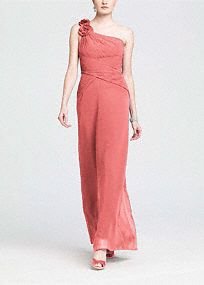 Modern and slimming, this gorgeous long chiffon one-shoulder dress has all the right accents.  One-shoulderis adorned with elegant flower details for an updated look that is on trend.  Bodice features asymmetrical neckline andall over ruching to keep this silhouette flattering and streamlined.  Chiffon skirt flows effortlessly to create a soft and romantic look.  Fully lined. Imported polyester. Dry clean only.