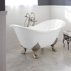 ARABELLA CAST IRON DOUBLE-SLIPPER TUB - Create the perfect focal point in your bathroom with the Arabella Cast Iron Double-Slipper Tub, which features a freestanding design and an inviting shape set on regal lion's paw feet.