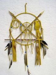 Native American Navajo Made Small Ceremonial Peace Shield with Pipe - This open shield has crossed arrows (a sign of friendship), dreamcatcher, medicine wheel, and pipe. This item is handcrafted and therefore beading and feathers will vary. Certificate of Authenticity included.  Dimensions: 14 in. diameter.  $109.95