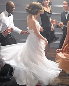 I love when wedding gowns flow! This is by David Fielden from Kleinfeld by verna