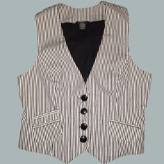 Blue and white vest Maurices brand. In good condition. There are ties in the back to make it fitted. Maurices Jackets & Coats Vests