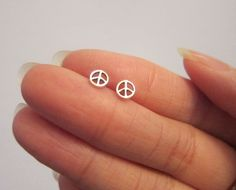 Tiny Sterling Silver Peace Sign Stud Earrings, Peace Jewelry, Dainty Earrings. by GreatJewelry4All on Etsy https://www.etsy.com/listing/168672480/tiny-sterling-silver-peace-sign-stud