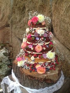Naked wedding cake with edible flowers