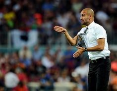 How to rock shorts sleeves and a tie.   Pep Guardiola.