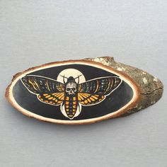 Wood slice with an original drawing of a death's door Inkspirednl