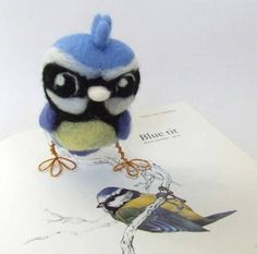 I really must try needle felting - the results can be so cute!  - Like this from feltmeupdesigns