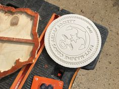 """Navy Marine Corps Relief Society crest/logo cut into 9.5"""" diameter corian (0.47"""") material to create a hotplate/trivet.  X-Carve CNC machine, V-Carve Pro software, 2mm endmil bit"""