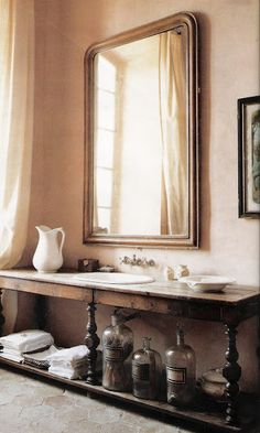 Beautiful Bathroom. Love the antique table converted into a bathroom sink/vanity.