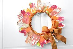 Leaf Handprint Wreath- That is awesome! Maybe my theatre class will help make this... after halloween