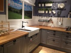 Ikea - Gray kitchen cabinets with butcher block counter top