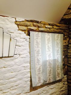 Celia Birtwell blind and antique mirror in our Rustic Barn Studio Let.