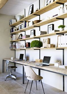 Raw wood shelves and desktops supported by iron brackets with shearling desk chair.