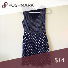Polka-Dot Summer Dress | Charming Charlie  Brand new with tags, never worn!! Adorable navy and cream colored polka-dot summer dress from Charming Charlie | V-neck style in the front | Fitted bodice with buttons down the back | Cut-out on the lower back | Flattering skirt that flows outward | Charming Charlie Dresses Mini
