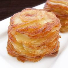 Mini Pommes Anna---definitely going to try this soon!  Made for superbowl--turned out great, def need a mandoline slicer or good food processor b/c slicing all those potatoes SUCKS!