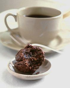 Chocolate Almond Macaroons - Martha Stewart Recipes... egg whites, sugar, cocoa powder, almond flour, shortening, chocolate