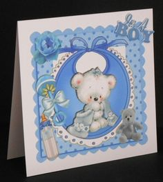 Cuddly teddy with his blanket bottle on bib in frame 8x8 by Joan Prince