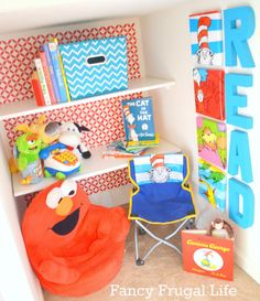 Royal Design Studio wall stencils used in children's book nook with bright bold colors and Dr. Seuss theme - DIY Kids room and boys room makeover with stencils - via Fancy Frugal Life.