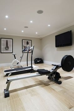 would love for a fraction of the basement to be a workout room...Like how this one is done with light tones keeping it feeling fresh