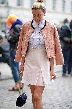 Tone-on-tone pink, and the latest way to wear a jacket, draped around the shoulders.   - ELLE.com