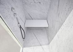 Corian® Folding Seat for the steambath + shower H_HAMMMAM with inner cladding in White Carrara Marble.