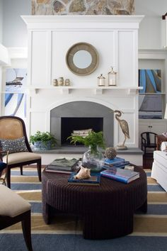 Fireplace surround with molding and mantel with corbels. Grey raised hearth. Fireplace inspiration.