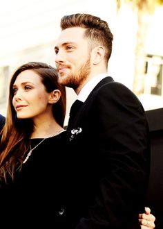 Elizabeth Olsen and Aaron Taylor-Johnson at the premiere of Godzilla in Hollywood. (These two are adorable!)