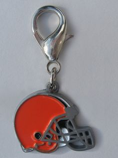 Officially Licensed NFL Team Charms Perfect gift for four-legged fans of the Cleveland Browns! These jewelry-quality charms are crafted from antiqued, lead-safe pewter, and are hand- enameled.   Size: 7/8 x 1 3/4 in.   Made in the USA