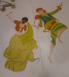 Couple playing dandiya.