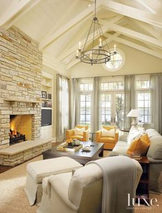Luxe magazine - Dreamy creamy sunshine living room with stone fireplace.