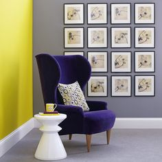 Here's a decorating idea for the control freaks among you - rows of same-sized photos or artwork create a feature in the corner of this living room. The sumptuous nature of the purple velvet armchair is accentuated when set next to this zesty yellow wall.