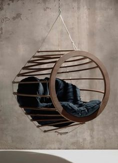 This is like a really arty version of our globo chair: http://www.hammockisland.co.uk/globo-wooden-hanging-egg-chair-green/