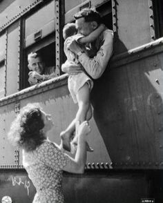 Wife of a departing soldier lifts her son for farewell embrace. Oklahoma, 1945. - Click image to find more History Pinterest pins