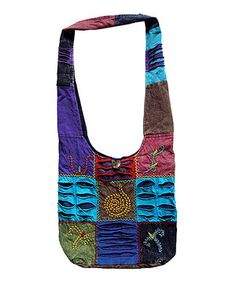 Tote the essentials in standout style with this one-of-a-kind handcrafted bag. Boasting bright bursts of color and pretty patchwork, this bag brings breezy boho flair to any ensemble. Note: Because this piece is completely handmade, colors may differ dramatically from what is pictured.
