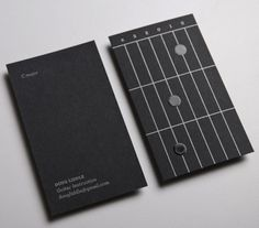 A guitar instructor's fretted business cards...      ...which double as chord flash-cards.