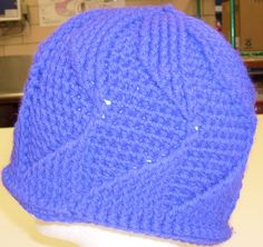 Hat. Very easy to make. I really need to get a different camera this hat is actually Purple.
