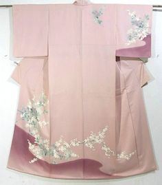 This is a Houmongi Kimono with a design of 'sazanka'(camellia) and 'ume'(Japanese plum), which is dyed.