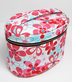 Downloadable instructions and pattern for making this zippered vanity bag.  These pouches are a perfect size to hold your cosmetics.  These are also great for using purse organizer within...