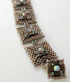 Boxcar Beauty Bracelet Tutorial, Stitch: peyote, herringbone, Beads Used: delicas, 14s or 15s, 3mm cubes, 4mm bicone, Designer: Carole Ohl, Price: $6.95