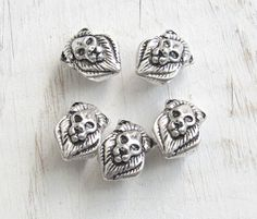 Lion head beads, set of 5, lion charms, lion beads, silver lion, african lion beads, animal beads, large hole beads, cat head, european bead by GemShopSupplies on Etsy https://www.etsy.com/listing/501516191/lion-head-beads-set-of-5-lion-charms