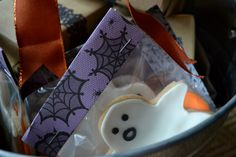 Halloween/Birthday party favors. Legos wrapped in craft paper and Halloween shaped cookies.